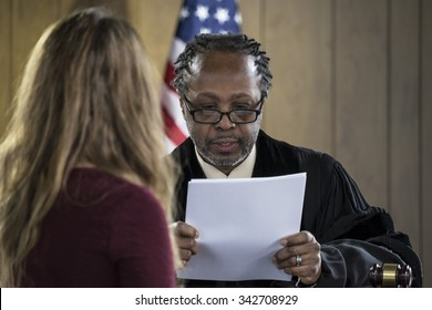 Female attorney addressing an African American judge in court