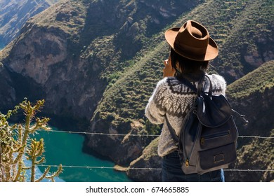 Female with backpack overlooking the valley in Huancaya, Peru