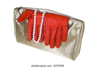 Female bag with gloves and costume jewellery on a white background