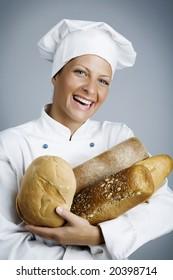 female baker with hands full of bread