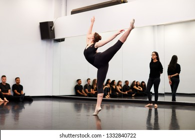Female Ballet Student At Performing Arts School Performs For Class And Teacher In Dance Studio