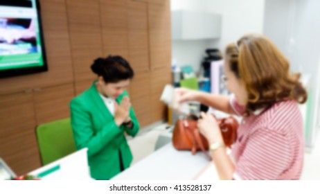 female bank employees sawatdee a senior customer blur image