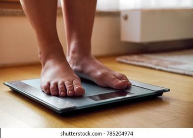 Female bare feet on the digital scale