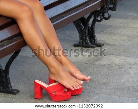 in Bare heels feet high