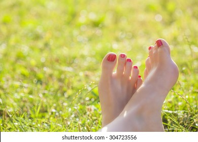 Female barefoot in the grass