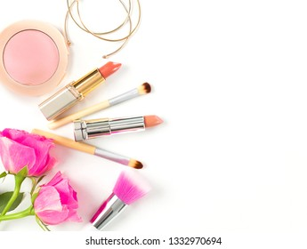 Female beauty items on white background. Make up products, foundation, brushes, flowers