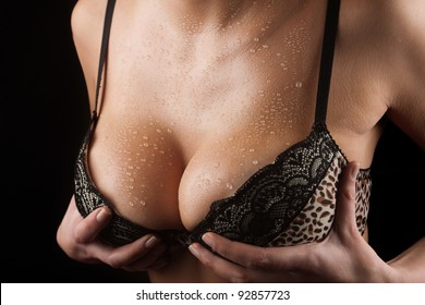 female big sexy wet breast  on black background