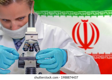 Female biochemist looking through a microscope against Iran flag background. Medical technology and pharmaceutical research and development of science concept in Iran