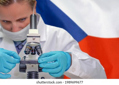Female biochemist looking through a microscope against Czech Republic flag background. Medical technology and pharmaceutical research and development of science concept in Czech Republic
