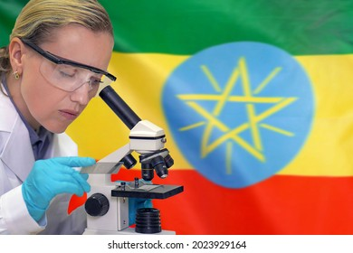 Female biochemist mixing substances to study under the microscope against Ethiopia flag background. Medical technology and pharmaceutical research and development of science concept in Ethiopia
