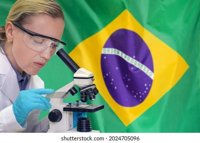 Female biochemist mixing substances to study under the microscope against Brazil flag background. Medical technology and pharmaceutical research and development of science concept in Brazil