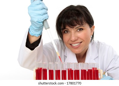 Female biologist, hematologist, holding a manual pipette with sample from test tubes.