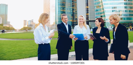 Female biz members talking outside and calling by smartphone. Concept of decision making and team work. Responsible people in business clothes changing work ideas.
