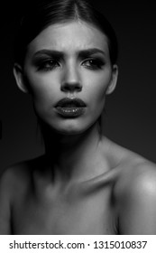 Female black and white portrait. Emotions, anxious, perplexed, angered.