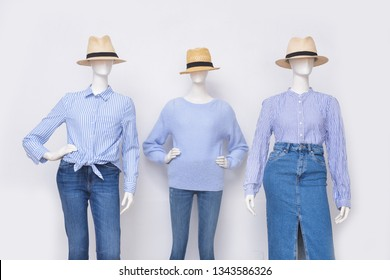 female blue clothing with skirt jeans ,blue jeans hat on three mannequin