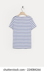 A female blue stripe t-shirts back side with wooden hanger isolated white background.
