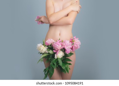 Female body. Beautiful girl with flowers. Gynecology and underwear, women's health. Youth and freshness, purity, flowering. Female diseases. Breast and vagina. Slender girl with a flat stomach