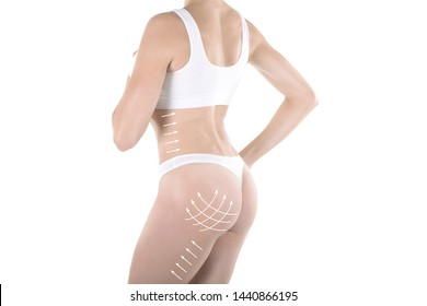 Female body and bum in base underwear. Lifting marking with arrows in womans butt and hips, isolated on white. Plastic surgery, buttock augmentation, dieting, wellness, health, medicine, liposuction
