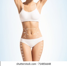 Female body in white slimming underwear