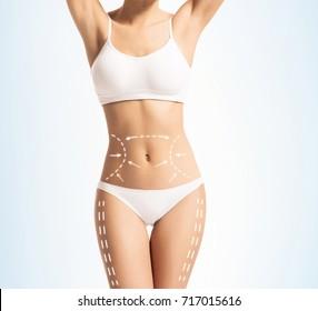 Female body in white slimming underwear