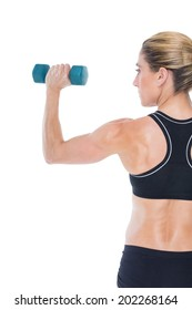 Female bodybuilder holding a blue dumbbell on white background