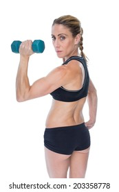 Female bodybuilder holding a blue dumbbell looking at camera on white background