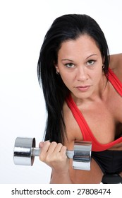 A female bodybuilder in a sexy red sports bra lifts a chrome dumbbell.