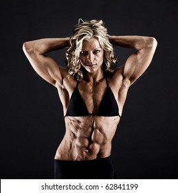 Female bodybuilder with solid defined abs