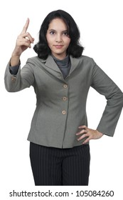 Female boss angry by pointing her finger isolated over white background