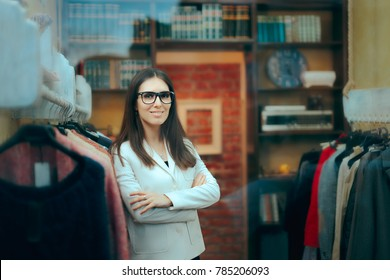 Female Boss Entrepreneur Small Business Owner inside Store. Portrait of a business woman manager in her clothing shop