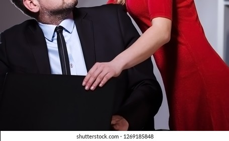 Female boss misbehave with assistant inside office. Sexual harassment at workplace.