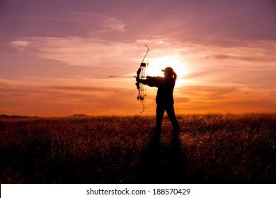 Female Bowhunter at Sunset