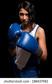 Female boxer in blue. Studio shot over white.