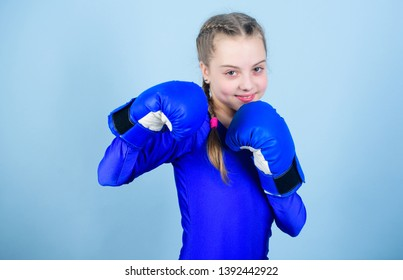 Female boxer change attitudes within sport. Feminism concept. With great power comes great responsibility. Boxer child in boxing gloves. Girl cute boxer on blue background. Rise of women boxers.