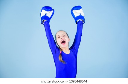 Female boxer change attitudes within sport. Rise of women boxers. Free and confident. Girl cute boxer on blue background. With great power comes great responsibility. Boxer child in boxing gloves.