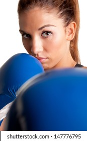 Female boxer ready to fight, isolated in a white background