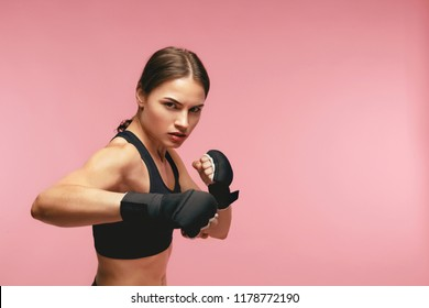 Female Boxer. Sportswoman Training In Boxing Bandages