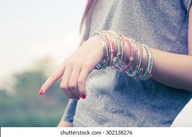 female with bracelets