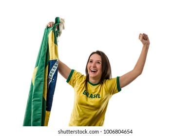 Female brazilian fan celebrating on a white background.
