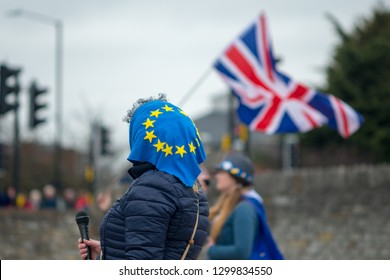 female Brexit protestor with Union jack flag in background