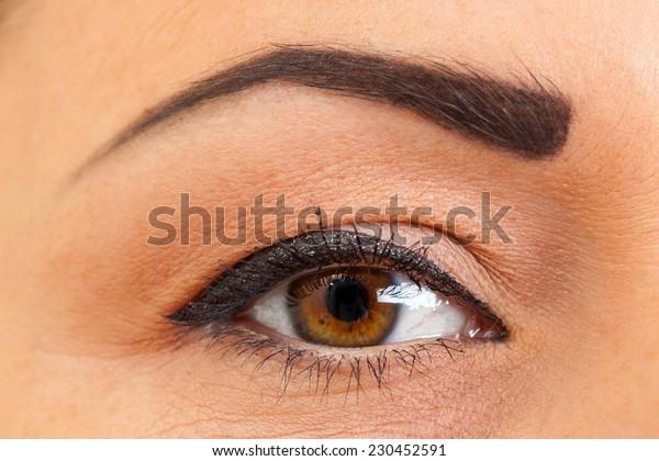 female brown eye with make-up, macro