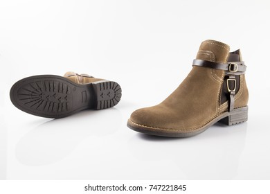 Female brown leather boot on white background, isolated product, comfortable footwear.