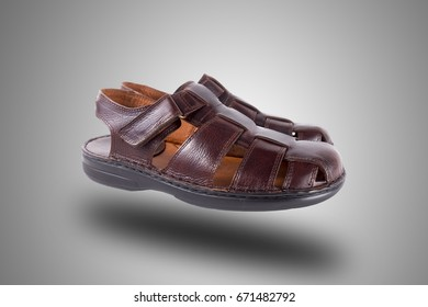 Female Brown Sandal on Grey Background, Isolated Product, Top View, Studio.