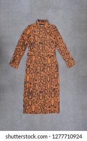 female brown snake pattern  sundress on gray background