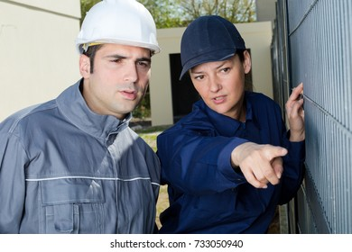 female builder pointing at something outdoors