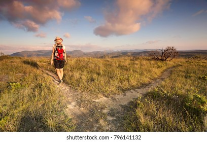 Female bushwalker hiking in the area of the Blue Mountains known as The Explorers Way