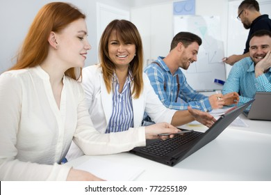 female business colleagues using laptop during meeting at the boardroom people connectivity technology internet online research confidence inspiring achieving communication corporate