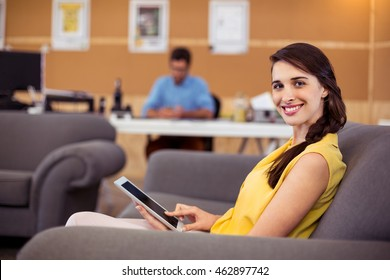 Female business executive using digital tablet in office