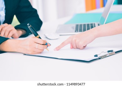 female business hand signing contract document