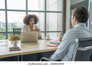 Female business is human resource manager , are interviewing male employees for recruitment at office